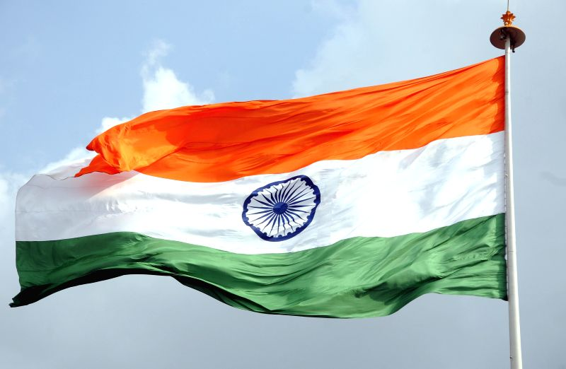 The Indian flag flutters in the skies of New Delhi on Aug 14, 2014.