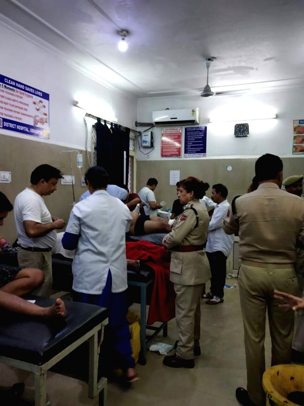 The injured being treated at a hospital after a vehicle carrying pilgrims to the valley met with an accident near the Birma Bridge by-pass of Jammu-Srinagar highway in Jammu and Kashmir's ...