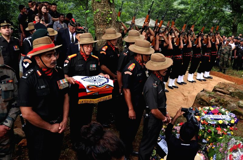 The last rites of Major David Manlun, a young Indian Army officer who was killed during an encounter with militants in Mon district of Nagaland, underway at Regimental Cemetery of Shillong ...
