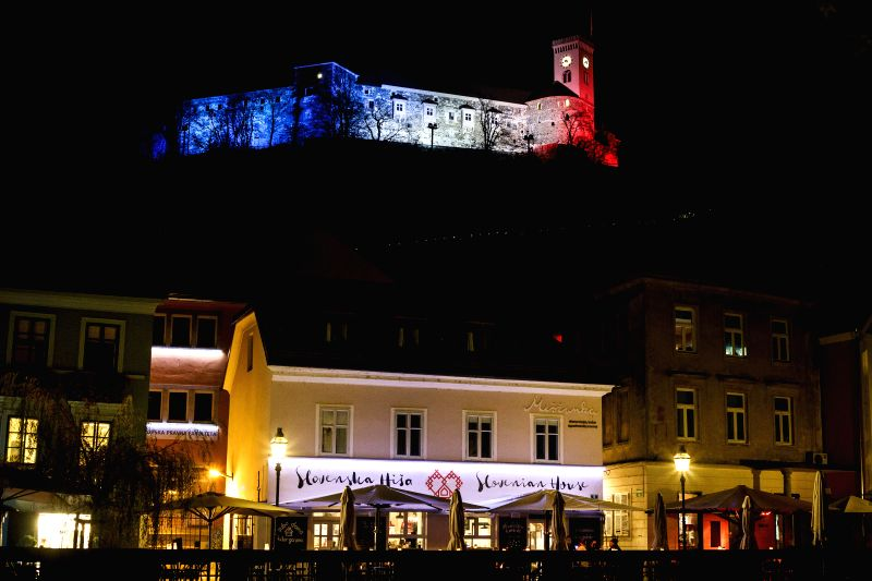The Ljubljana castle is lit up in colours of French national flag to show solidarity with Paris and pay tribute to the victims of terror attacks of Nov. 13, in ...