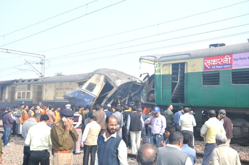 The mangled bogies of an EMU (electric multiple unit) shuttle train and an express train that collided head on near village Baghola in Palwal district of Haryana, about 80 km from New Delhi ...