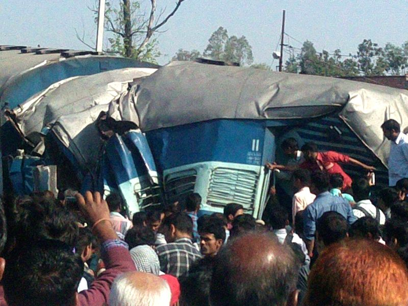 The mangled coaches of the Dehradun-Varanasi Janta Express that derailed in Raebareli of Uttar Pradesh on March 20, 2015. Four people were killed and over 50 injured in the accident that involved two ...