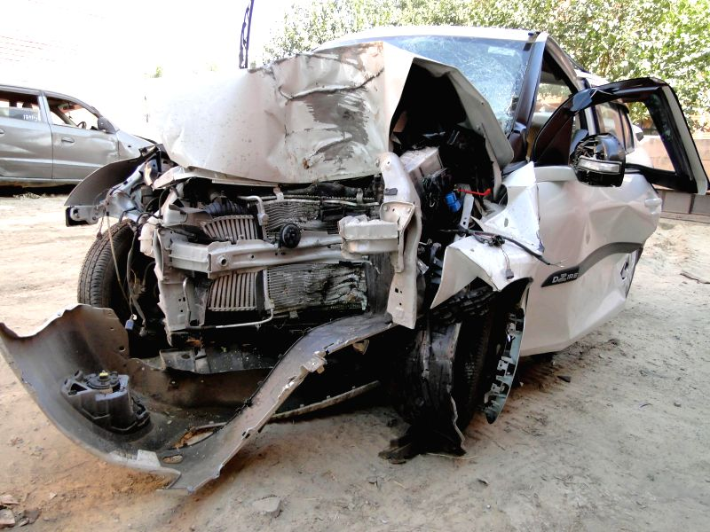 The mangled remains of the car which which met with an accident in Kanjhawala area on New Delhi on Dec 1, 2014. At least four people died and five others were injured in the accident.