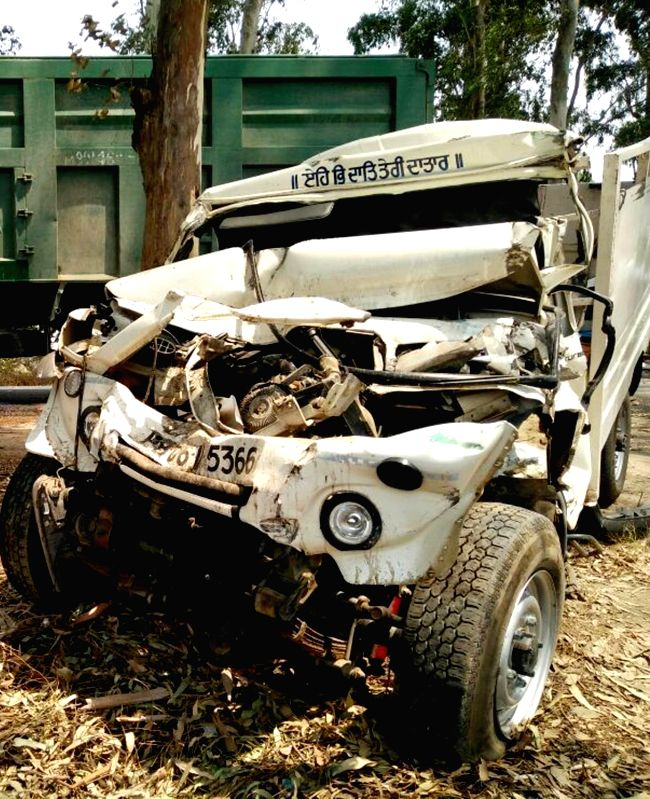 The mangled remains of the vehicle that crashed into a stationary truck on Gurdaspur-Amritsar highway near village Boparai being treated at a hospital near Amritsar on May 22, 2016. At ...