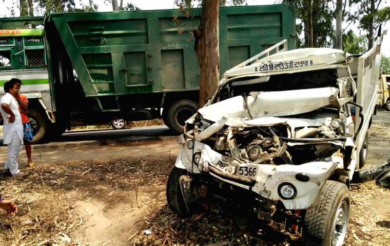 The mangled remains of the vehicle that crashed into a stationary truck wrongly parked at Boparai village near Amritsar on May 22, 2016. At least nine people were killed in the accident.