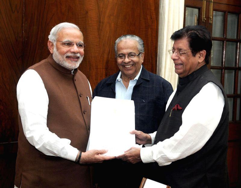 The Member of Parliament and President of the Indian Union Muslim League, E. Ahamed presents a cheque for Rs 25 lakh rupees to Prime Minister, Narendra Modi, towards the Prime Minister's National ... - Narendra Modi