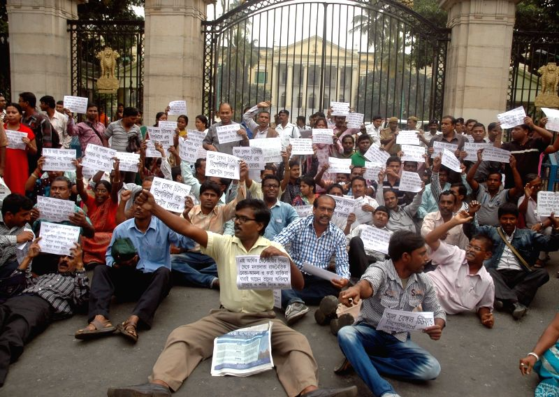 The members of All Bengal Chit fund Depositors and Agent Forum stage a demonstration in Kolkata, on Dec 2, 2015.