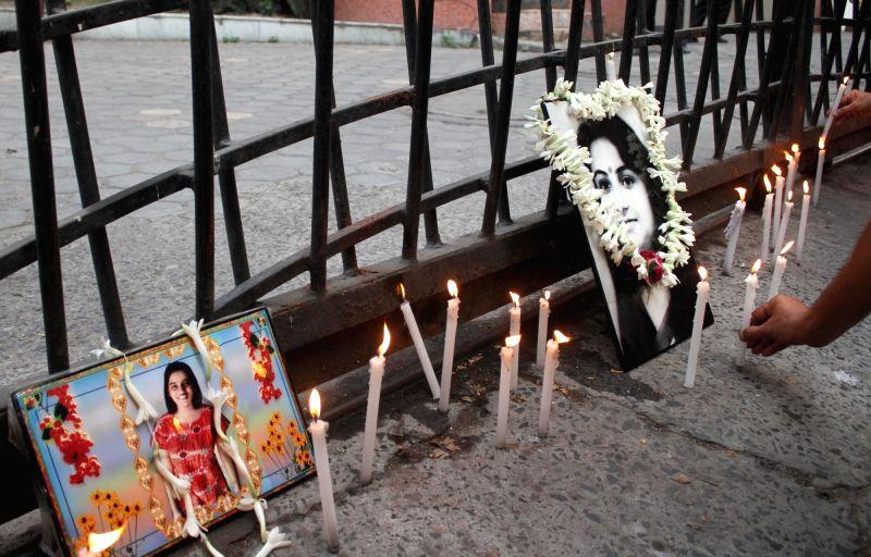 The members of AMRI Fire Victim Association pay tribute to the victims of AMRI Fire in Kolkata, on Dec 9, 2015.