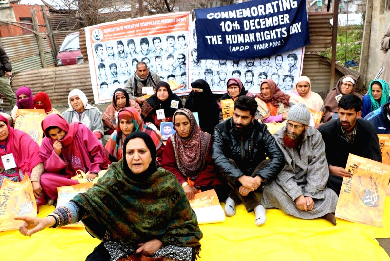 The members of Association of Parents of Disappeared Persons (APDP) stage a demonstration on International Human Rights Day in Srinagar, on Dec 10, 2015.