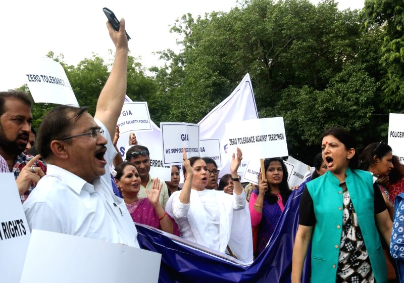 The members of Group of Intellectuals and Academicians participate in a protest march against recent terror attacks in Jammu and Kashmir, in New Delhi on July 19, 2016.