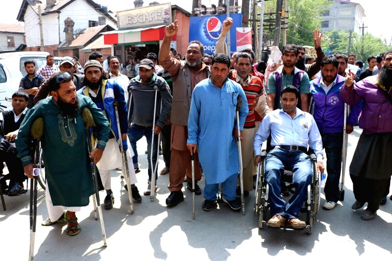 The members of Jammu and Kashmir Handicapped Association stage a demonstration to press for their demands in Srinagar, on May 10, 2016.