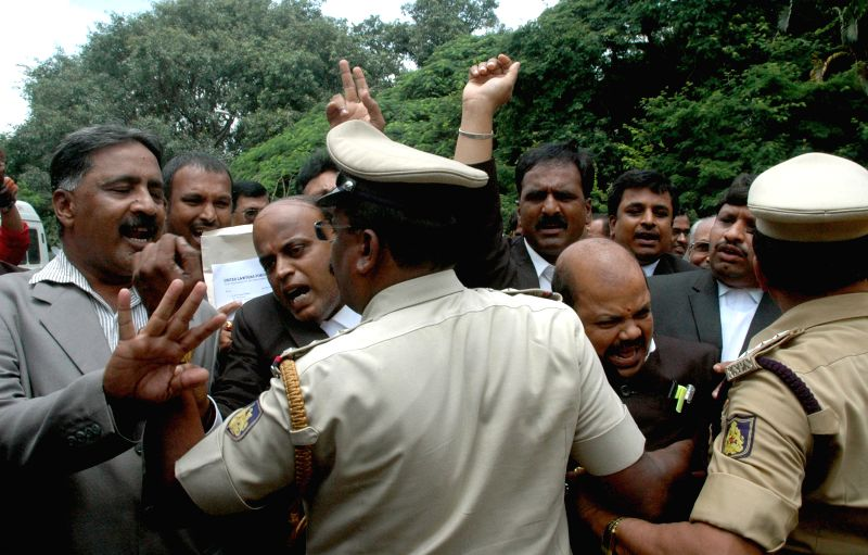 The members of Karnataka State Bar Council courting arrest during their protest against Karnataka Lokayukta Justice Y Bhaskar Rao demanding resignation for alleged corruption charges, in ...