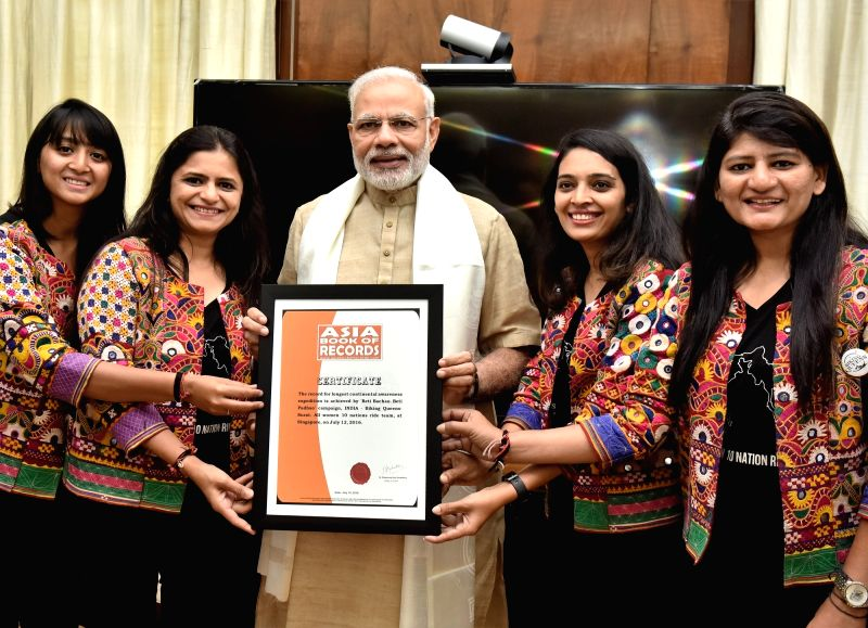 The members of the Biking Queens Sarika Mehta, Durriya M Tapia, Yugma Desai and Khyati N Desai meets Prime Minister Narendra Modi after completing their All Women 10 Nation Ride in New ... - Narendra Modi, Yugma Desai and Khyati N Desai