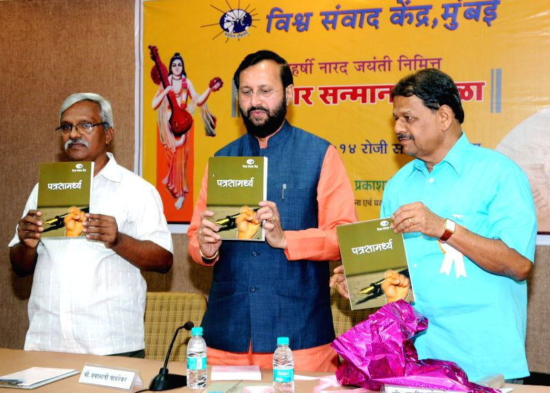 The Minister of State for Information and Broadcasting (Independent Charge), Environment, Forest and Climate Change (Independent Charge) and Parliamentary Affairs, Prakash Javadekar releasing the ...