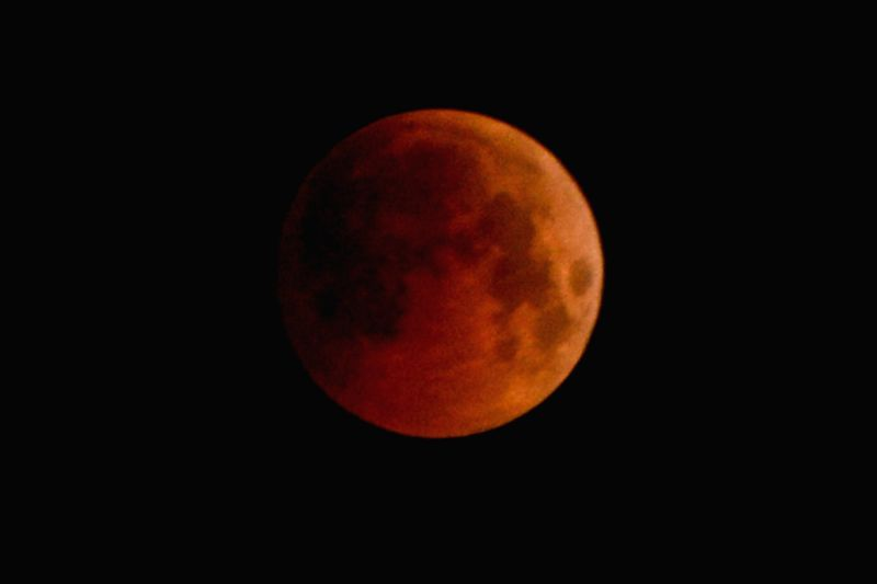 "The moon appears red, commonly known as the ""blood moon"" as it enters the Earth's darker shadowumbraduring the longest lunar eclipse of the century, as seen from Ajmer on ..."