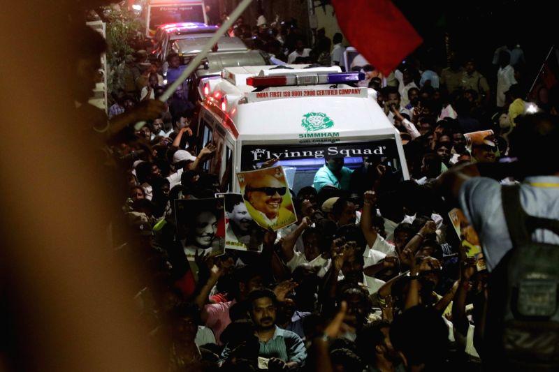 The mortal remains of DMK President M. Karunanidhi being taken to his his home at Gopalapuram in Chennai on Aug 7, 2018.
