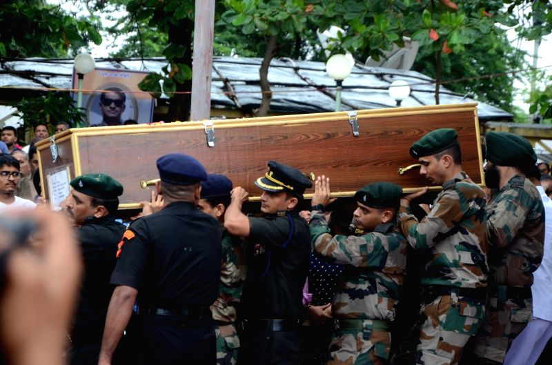 The mortal remains of Major Kaustubh P. Rane being taken for his last rights, in Maharashtra's Thane on Aug 9, 2018. Thousands of people, including grieving family members, bid a tearful ...