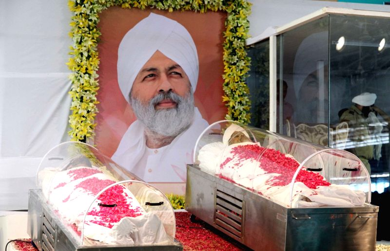 The mortal remains of spiritual leader and Sant Nirankari Mission head Baba Hardev Singh who died in a road accident in Canada; in New Delhi, on May 16, 2016. Also seen the body of Avneet ... - Hardev Singh