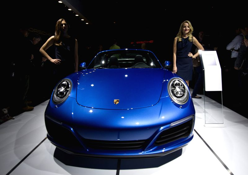 The new Porsche 911 Targa 4s is presented at the Los Angeles Auto Show in Los Angeles, the United State, Nov. 18, 2015. Some 30 new vehicles will make their ...