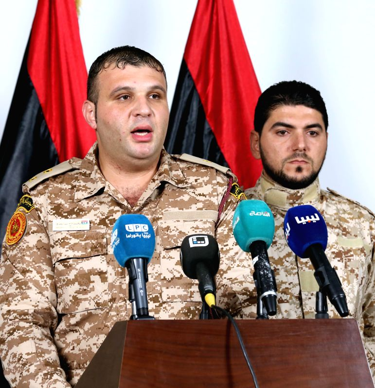 The official spokesman for the Ministry of Defense of the National Salvation Government Mohammed Abdul Kafi speaks at a press conference in Tripoli, Libya, Oct. 27, ...