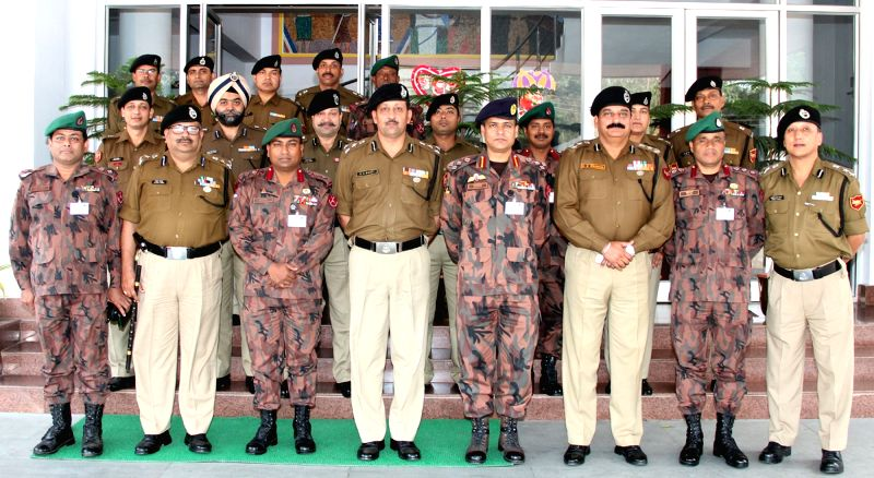 The officials of Border Security Force (BSF) officials and Border Guard Bangladesh (BGB) poses for photograph after completion of five day joint recce of the India and Bangladesh border ...