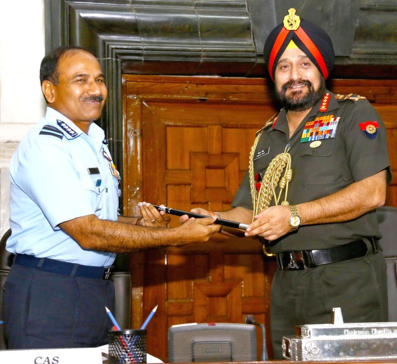 The outgoing Chairman, Chief of Staff Committee (COSC) and Chief of Army Staff, General Bikram Singh handing over the COSC baton to the new Chairman, Chief of Staff Committee (COSC) and Chief of the .