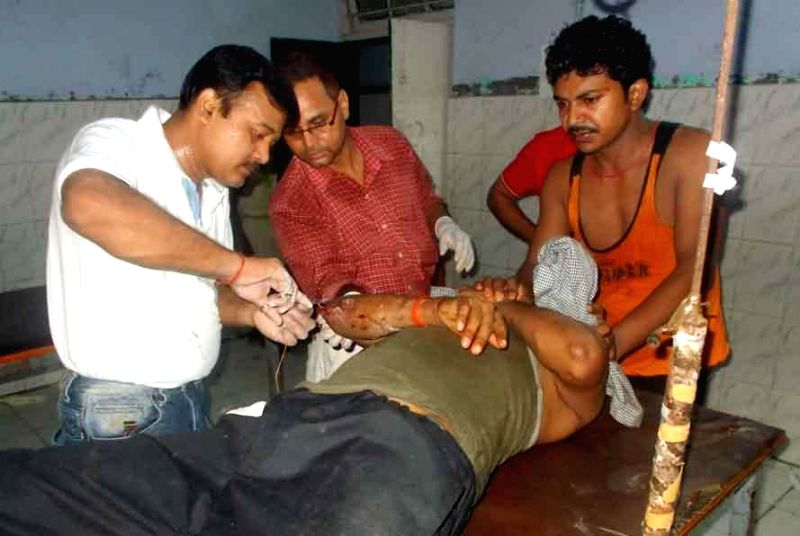 The passengers of Delhi-Dibrugarh Rajdhani Express which was derailed near Goldenganj railway station in Bihar's Saran district on June 25, 2014 being treated at a hospital. At least four people were