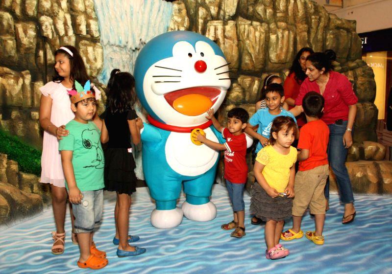 The popular robotic cat ,Doraemon with kids during an adventurous ride at DLF Palace Saket, in New Delhi,11 May 2013( Photo:Amlan Paliwal/IANS)