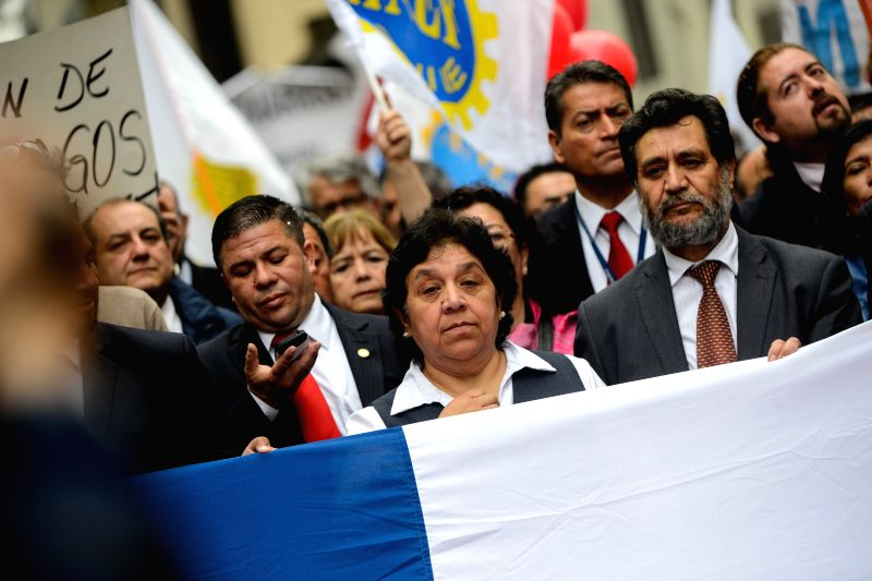 The President of National Association of Employees of the Civil Registry and Identification (ANERCICH, for its acronym in Spanish), Nelly Diaz (C), takes part in a ...
