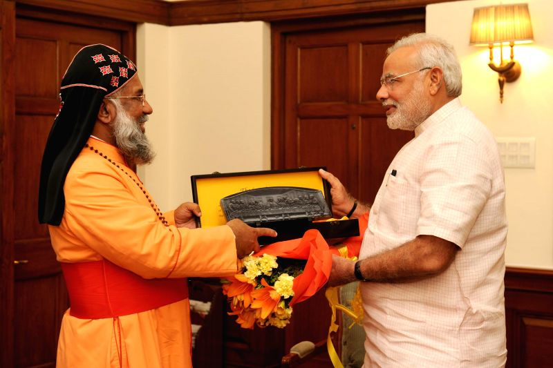 The President of the Catholic Bishops' Conference of India, Baselios Cleemis Cardinal Thottunkal calls on Prime Minister Narendra Modi, in New Delhi on August 18, 2014. - Narendra Modi