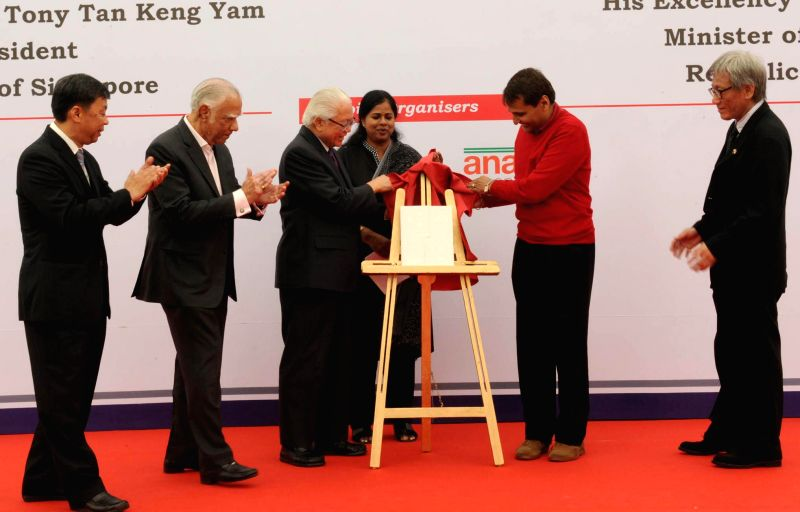 The President of the Republic of Singapore Dr. Tony Tan Keng Yam at  launch of a book, in New Delhi on Feb 10, 2015. Also seen the Union Minister for Railways, Suresh Prabhakar Prabhu. - Suresh Prabhakar Prabhu