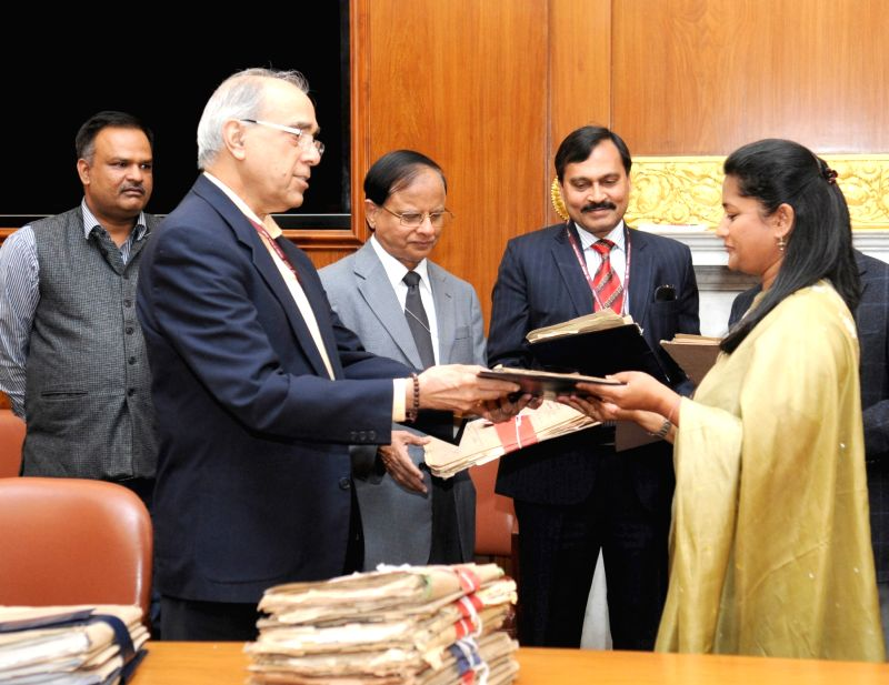 The Principal Secretary to the Prime Minister, Nripendra Misra officially hands over the first set of files related to Netaji to the DG, NAI, in New Delhi on Dec 4, 2015. Also seen ... - P