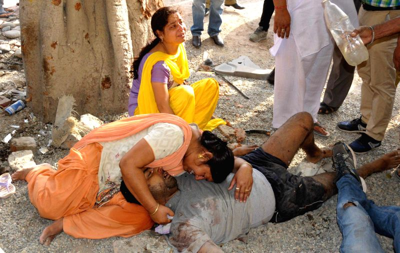 The relatives of the persons who were killed in a car accident mourn their death in Amritsar on May 5, 2014.