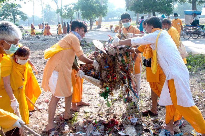 The sadhaks from Shantikunj Ashram clean Haridwar after Kanwar mela on Aug 14, 2015.