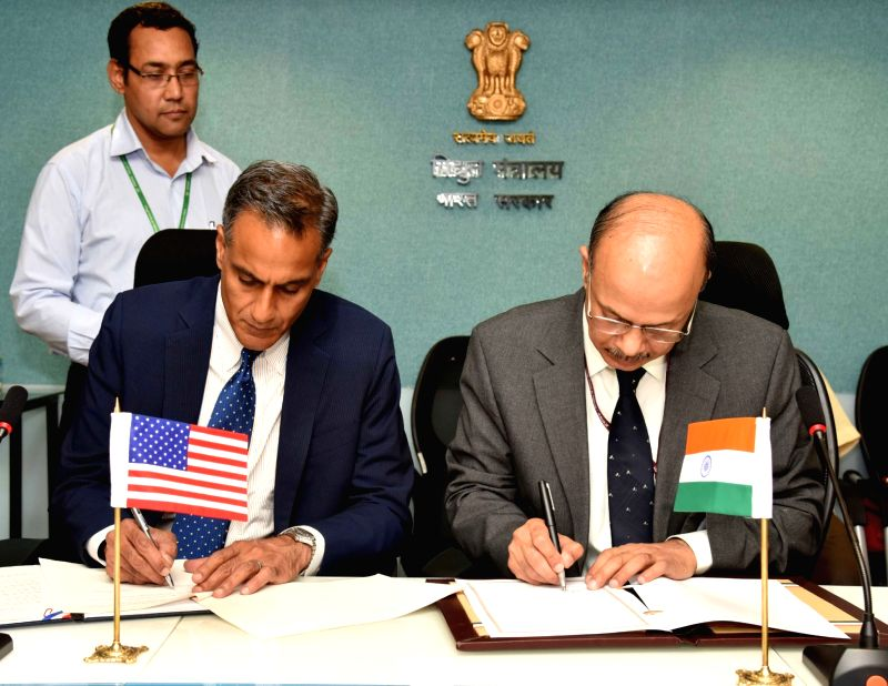 The Secretary, Ministry of Power, P.K. Pujari and Ambassador of US to India, Richard R Verma sign an MoU between the Ministry of Power and US Government to enhance cooperation on energy ... - Richard R Verma
