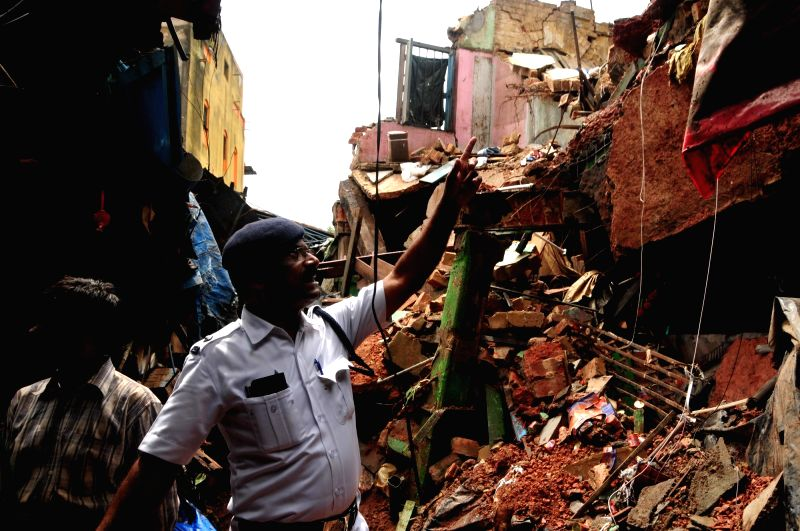The site where an old two-storey residential building near Sealdah's Baithakkhana Bazar area collapsed following heavy rains, in Kolkata on July 23, 2018. Two persons were killed and another ...