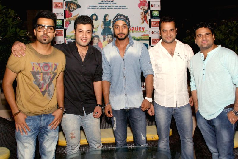 The star cast of upcoming Punjabi comedy film `Yaaran Da Katchup` Abhay Baiju Chabbra, Varun Sharma, Hardy Sandhu, Anil Juneja and Ranjan Sehgal, at a press meet in New Delhi on July 06,2014.(Amlan .. - Varun Sharma