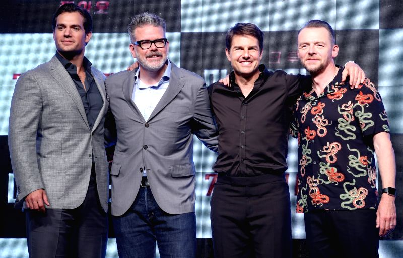 "The stars of the new movie ""Mission: ImpossibleFallout""Henry Cavill, Tom Cruise and Simon Pegg (L to R)along with director Christopher McQuarrie (2nd L)pose for a ... - Christopher M"