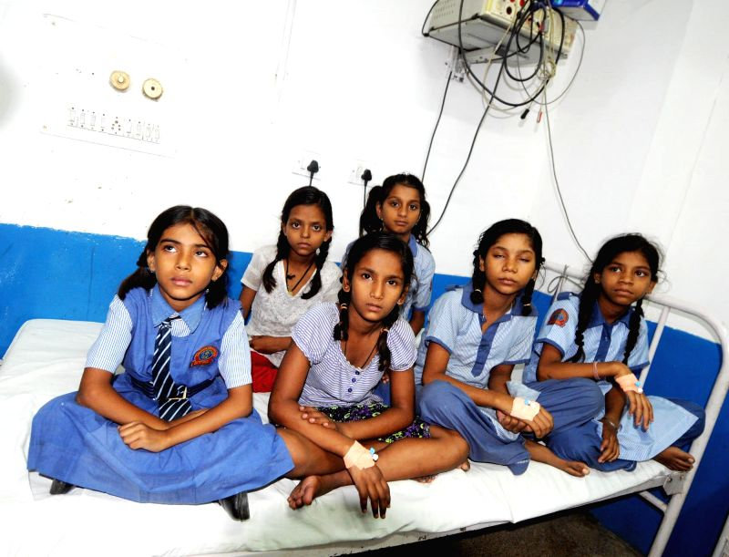The students of a government school admitted in Lal Bahadur Shastri Hospital of New Delhi on on July 3, 2014. Twelve students of the school aged between five and 12, were admitted to the hospital ...