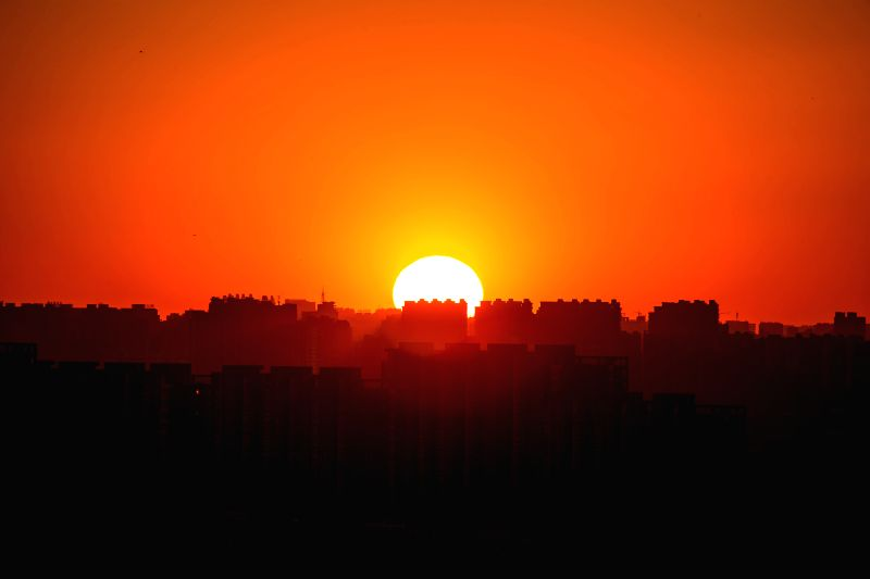 The sun rises in Beijing, capital of China, Dec. 2, 2015, after the lingering thick smog dispersed overnight. (Xinhua/Li Jianbo)