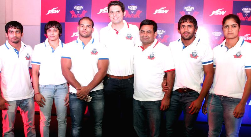 The team members of Bangalore Yodhha (owned by JSW Group) during the programme to unveil their team in Bengaluru, on Nov 21, 2015.