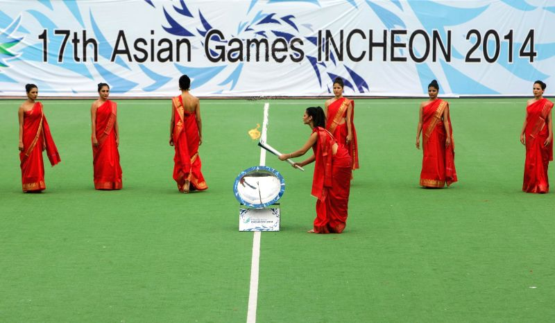 The torch carrying the flame for the 17th Asian Games Incheon 2014 is shown during the flame lighting ceremony at National Stadium in New Delhi on Aug. 9, 2014.