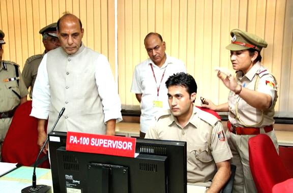 The Union Home Minister Rajnath Singh inspecting the functioning of Police Control Room (PCR), at Police Headquarters, in New Delhi on June 16, 2014. The Union Home Secretary, Anil Goswami is also ... - Goswami