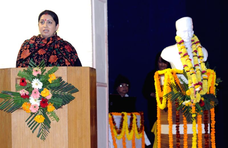 The Union Minister for Human Resource Development, Smriti Irani addresses at the launch of Madan Mohan Malviya National Mission on Teachers and Teaching, in Varanasi, Uttar Pradesh on Dec 25, 2014.