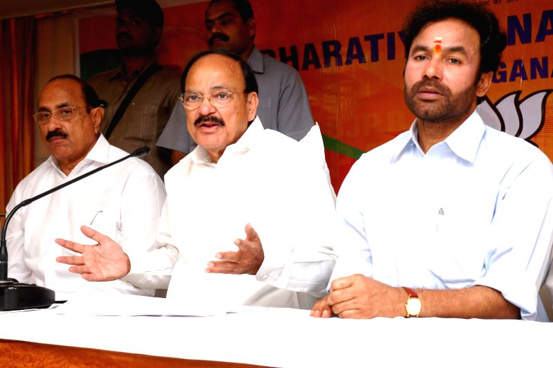 The Union Minister for Urban Development, Housing and Urban Poverty Alleviation and Parliamentary Affairs M. Venkaiah Naidu addresses a Press Conference on Land Acquisition Act, in Hyderabad on March ... - M. Venkaiah Naidu