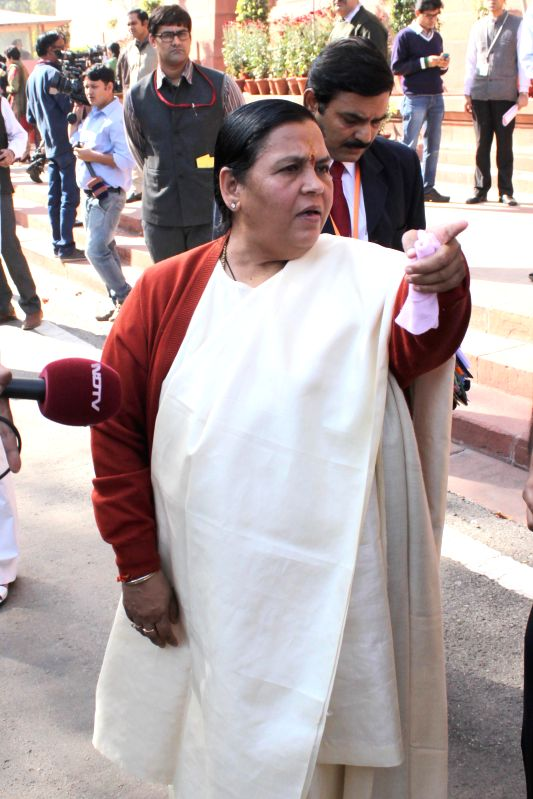 The Union Minister for Water Resources, River Development and Ganga Rejuvenation Uma Bharti at the Parliament premises in New Delhi, on Dec 1, 2014.