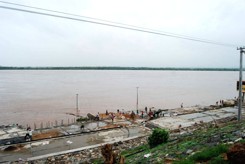 The view of a overflow Godavari river at Bhadrachalam in Khammam District of Telangana on June 23, 2015. Flood threat looms over parts of Telangana and Andhra Pradesh as heavy rains ...