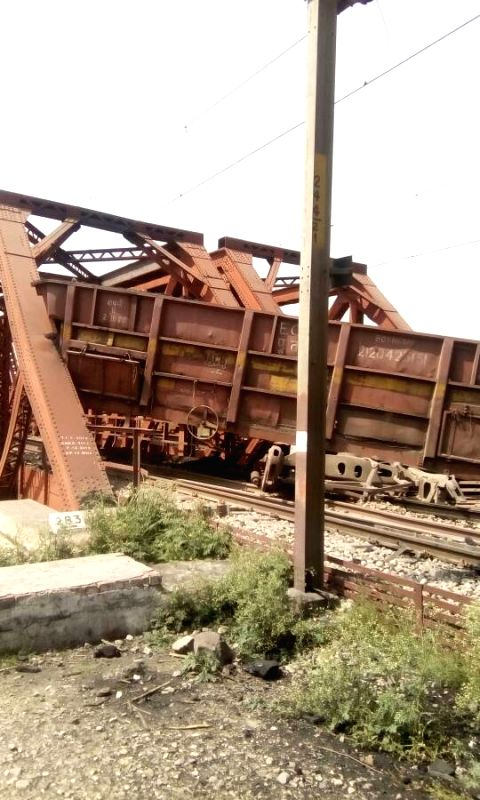 The wagons of a goods train loaded with coal that derailed in Haryana's Ambala district and fell into the bed of Markanda river on April 20, 2017.