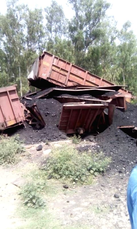 The wagons of a goods train loaded with coal that upturned after getting derailed in Haryana's Ambala district and fell into the bed of Markanda river on April 20, 2017.