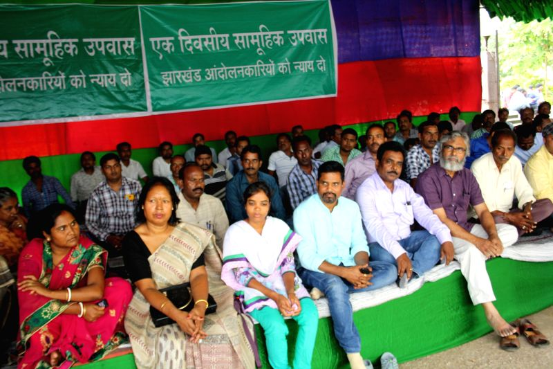 The workers of All Jharkhand Students Union (AJSU) participate during a hunger strike demanding justice for their party MLA, Kamal Kishore Bhagat in Ranchi  on June 27, 2015.